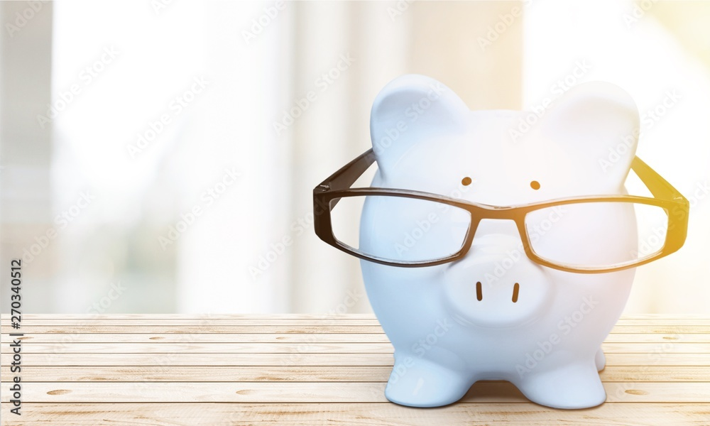 Fototapety, obrazy: Blue piggy bank in glasses on background