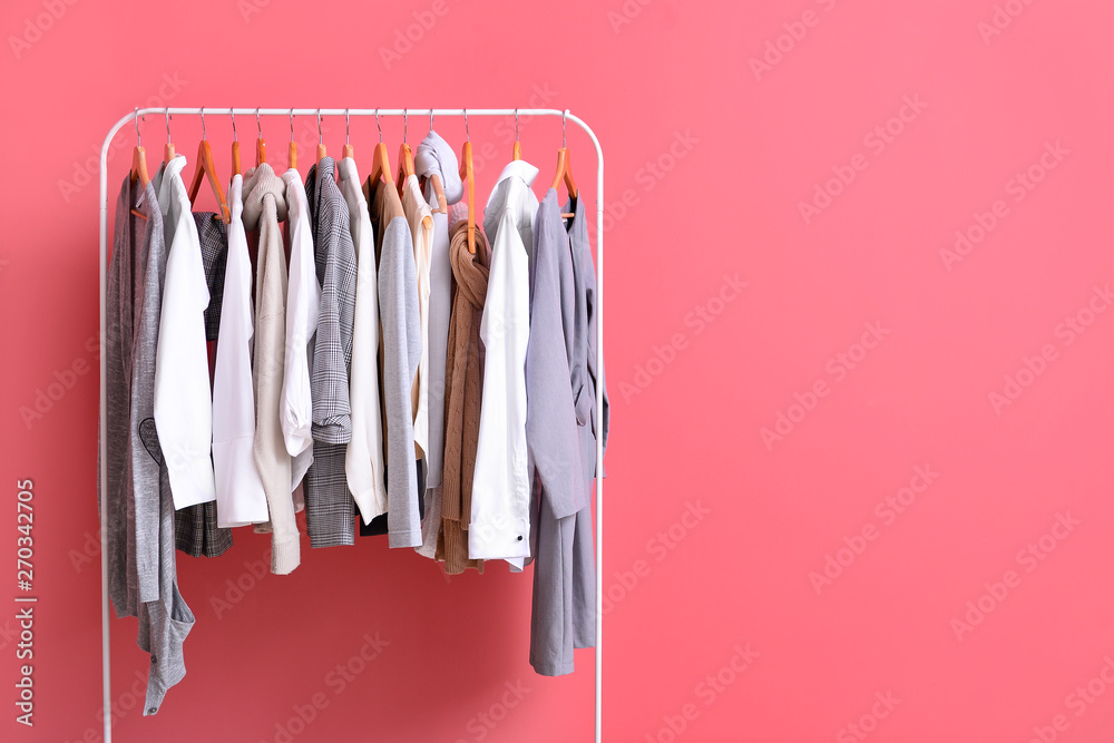 Fototapety, obrazy: Rack with stylish clothes on color background