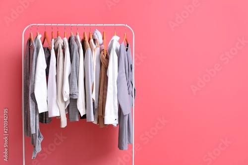 Obraz Rack with stylish clothes on color background - fototapety do salonu