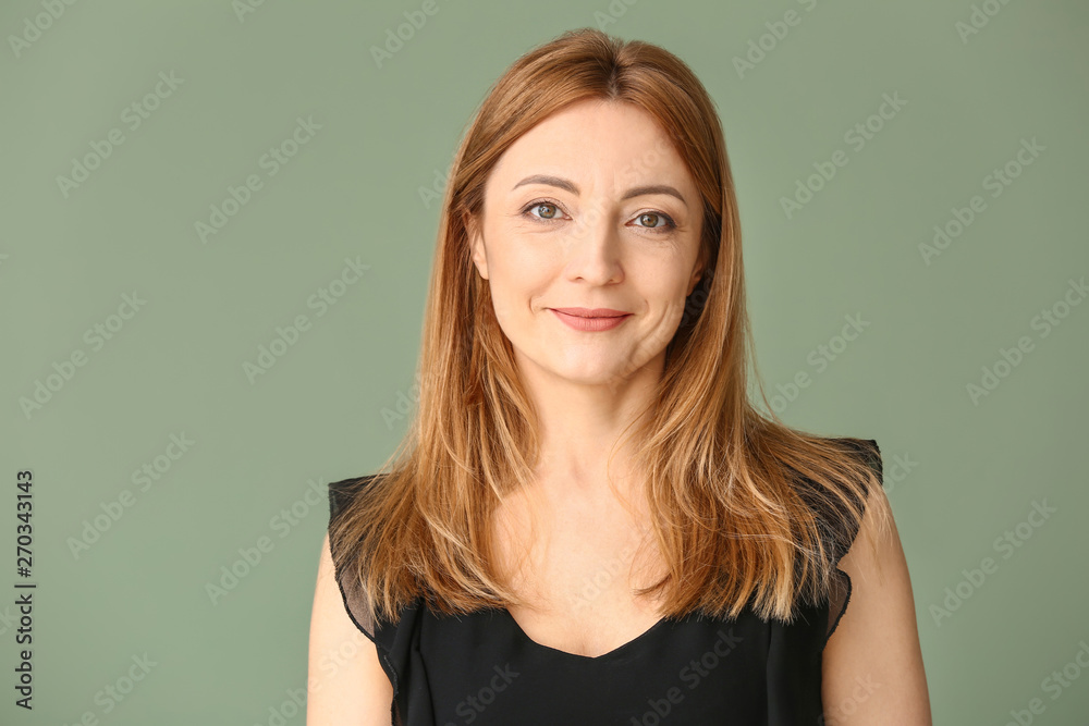 Fototapeta Portrait of mature woman on color background