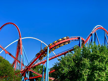 A Red Roller Coaster In A Amus...