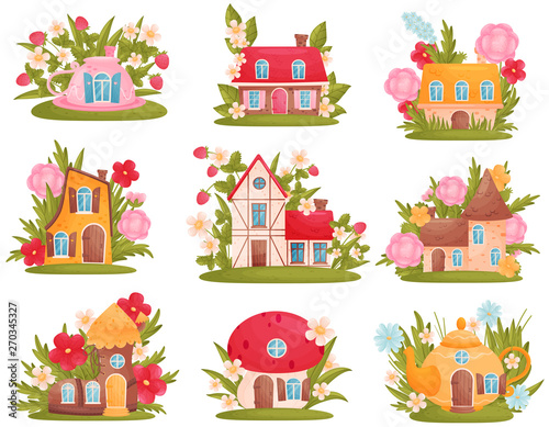 Foto Set of fabulous houses of different shapes among the flowers and grass