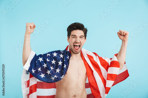 Cheerful shirtless man standing isolated over blue Canvas Print