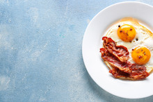 Plate With Tasty Fried Eggs An...