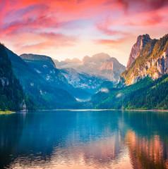 Fototapeta Rzeki i Jeziora Dramatic summer sunrise on Vorderer ( Gosausee ) lake. Impressive morninf scene of Austrian Alps. Upper Austria, Europe. Beauty of nature concept background.