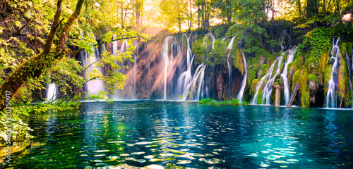 Photo sur Toile Cascades Last sunlight lights up the pure water waterfall on Plitvice National Park. Colorful spring panorama of green forest with blue lake. Great countryside view of Croatia, Europe.