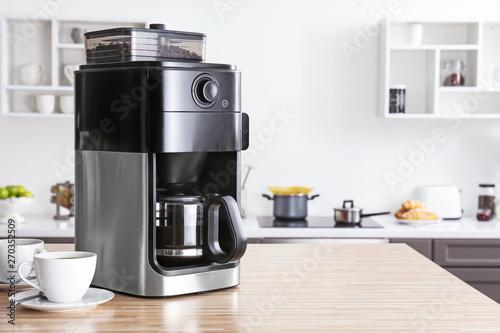 Modern coffee machine on kitchen table Wallpaper Mural