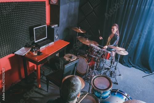 Woman receiving drum lessons from her music teacher Fototapeta