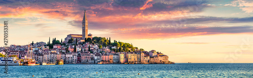 Great spring sunset of Rovinj town, Croatian fishing port on the west coast of the Istrian peninsula. Colorful evening seascape of Adriatic Sea. Traveling concept background.