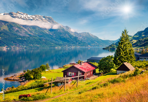 Foto auf Gartenposter Nordlicht Sunny summer scene in Lofthus village, Hordaland county, Norway. Great morning view of Hardangerfjord fjord. Beauty of countryside concept background.