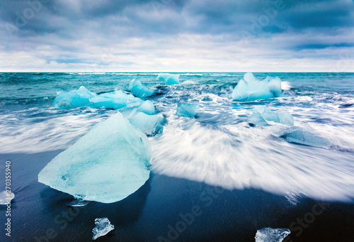 Poster Glaciers Blocks of ice washed by the waves on Jokulsarlon beach. Dramatic summer scene of Vatnajokull National Park, southeast Iceland, Europe. Beauty of nature concept background.