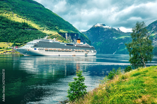Dramatic summer scene of Geiranger port, western Norway. Colorful view of Sunnylvsfjorden fjord. Traveling concept background. Instagram filter toned.