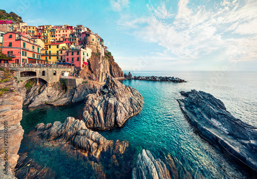 Canvas Prints Liguria Second city of the Cique Terre sequence of hill cities - Manarola. Colorful spring morning in Liguria, Italy, Europe. Picturesqie seascape of Mediterranean sea. Traveling concept background.