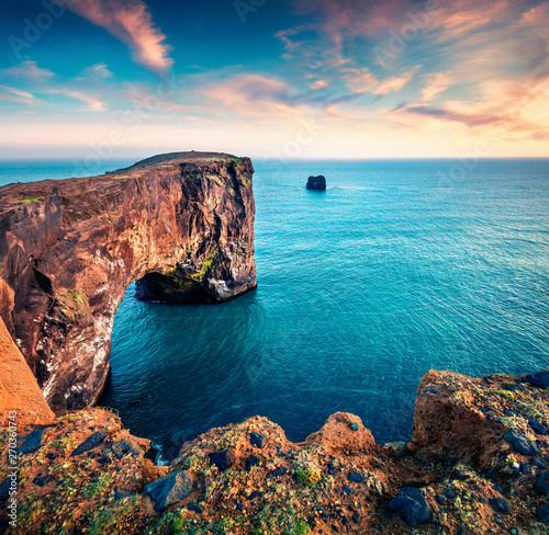 Foto auf AluDibond Dunkelbraun Incredible evening view of Dyrholaey arch. Dramatic summer sunset in Dyrholaey Nature Reserv, south coast of Iceland, Europe. Beauty of nature concept background.