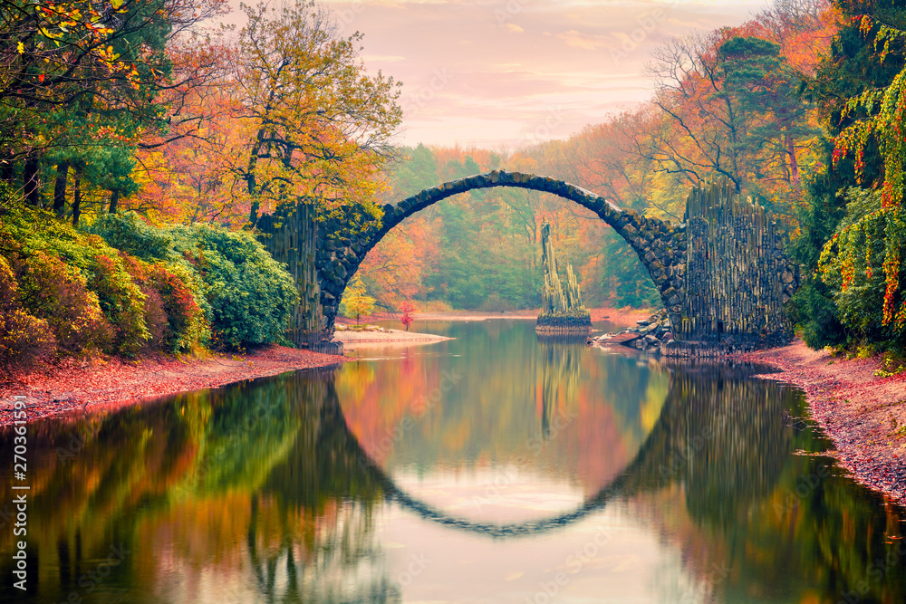 Fototapety, obrazy: Impressive sunset in Azalea and Rhododendron Park Kromlau, Germany, Europe. Picturesque autumn view of Rakotz Bridge (Rakotzbrucke, Devil's Bridge). Traveling concept background.