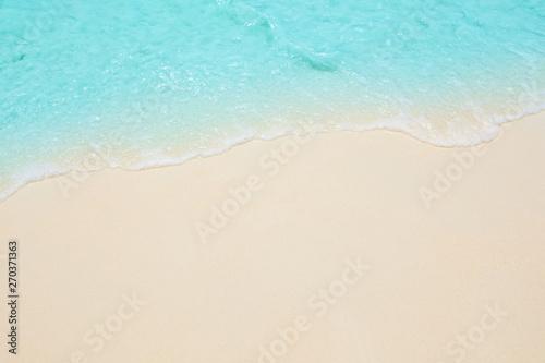 Foto auf Gartenposter Weiß Soft waves of blue sea on the Maldives beach for the background.