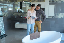 Couple Looking At Oval Bath In...