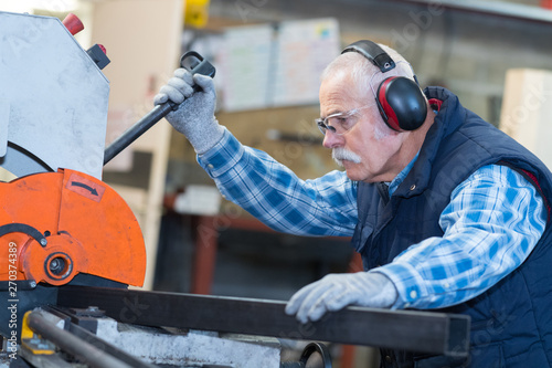 senior man operating machine in the factory