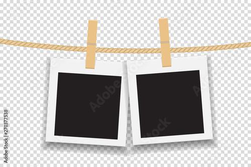 Fotografía  Blank photo frame hanging on line or rope. Vector illustration