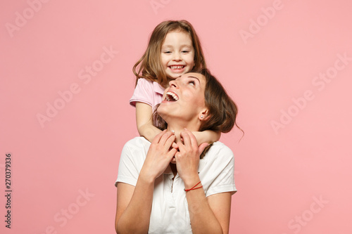 Fototapeta Woman in light clothes have fun with cute child baby girl. Mother, little kid daughter isolated on pastel pink wall background, studio portrait. Mother's Day, love family, parenthood childhood concept obraz
