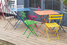 Metal Colorful Chair Seat In Summer Wood Terrace
