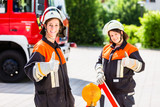 Female fire fighters setting up attention sign