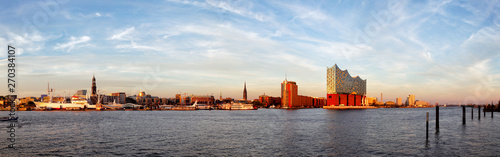 Panorama of the harbour of Hamburg with the Elbphilharmonie in evening light. - 270384107