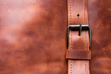 Closeup Of A Brown Leather Texture With A Belt. Copy Space