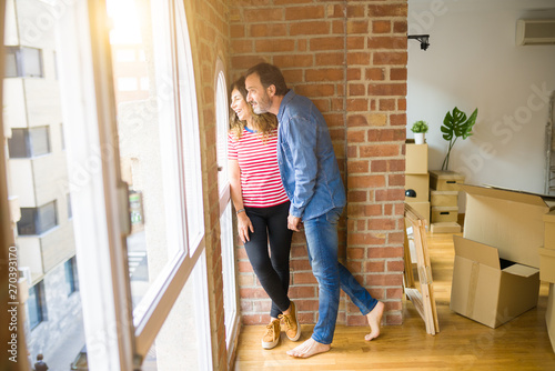 Fototapety, obrazy: Middle age senior couple moving to a new house, smiling happy in love with apartmant