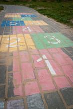 Children Game Hopscotch On Pavement