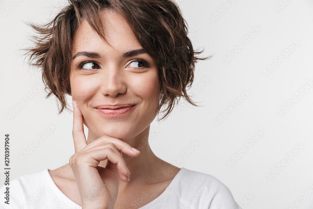 Fototapeta Portrait of beautiful woman with short brown hair in basic t-shirt smiling at camera