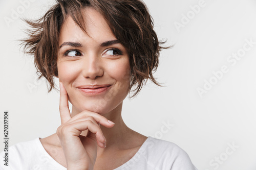 Portrait of beautiful woman with short brown hair in basic t-shirt smiling at camera