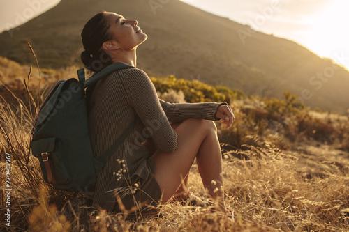 fototapeta na drzwi i meble Female hiker taking a rest