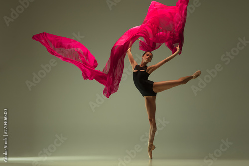 In de dag Dance School Graceful ballet dancer or classic ballerina dancing isolated on grey studio background. Woman with the pink silk cloth. The dance, grace, artist, contemporary, movement, action and motion concept.