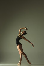 Graceful Ballet Dancer Or Classic Ballerina Dancing Isolated On Grey Studio Background. Showing Flexibility And Grace. The Dance, Artist, Contemporary, Movement, Action And Motion Concept.