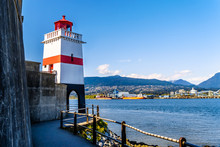 Brockton Point With The Famous Lighthouse On The Famous Seawall Pathway In Vancouver's Stanley Park In British Columbia, Canada