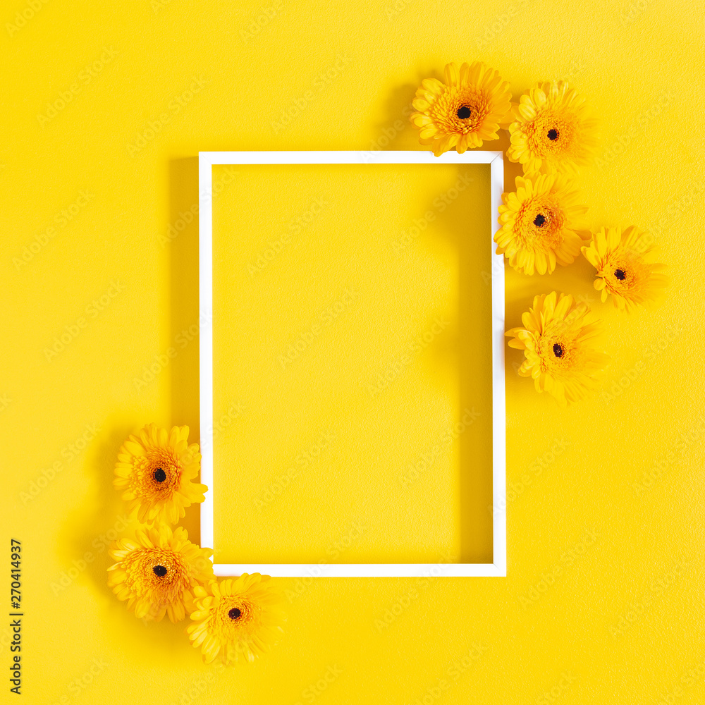 Fototapety, obrazy: Flowers composition. Yellow gerbera flowers, photo frame on yellow background. Flat lay, top view, copy space