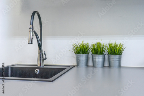 Fotomural  Kitchen sink and faucet in house interior
