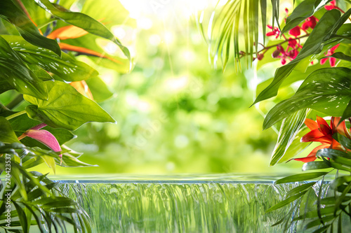 Poster Spa Tropical palm leaves,flower and small waterfall