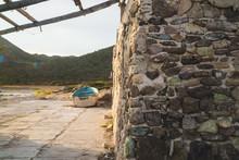 Stone Wall And Old Fishing Boa...