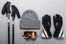 Ski Poles With Woolly Hat Goggles And Gloves