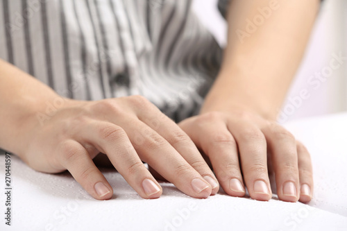 Poster Yoga school Blind person reading book written in Braille, closeup
