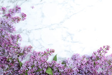 Blossoming Lilac Flowers On Marble Table, Flat Lay. Space For Text