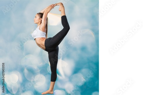 Fotografie, Obraz  Young beautiful woman doing Yoga on white background