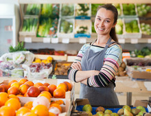 Glad Woman Store Worker In Supermarket