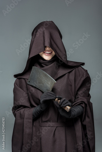 smiling woman in death costume holding cleaver isolated on grey Tablou Canvas