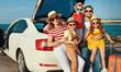 Leinwandbild Motiv happy large family  in summer auto journey travel by car on beach.