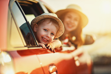 Obraz na Plexihappy family mother and child boy goes to summer travel trip in car