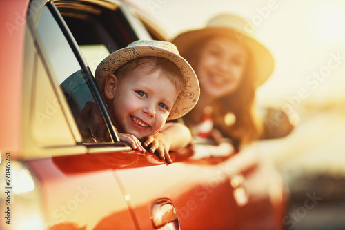 obraz dibond happy family mother and child boy goes to summer travel trip in car