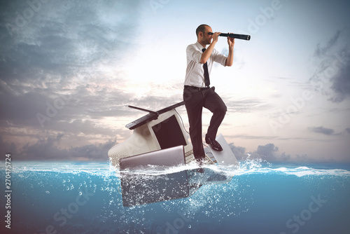 Businessman sailing on a laptops and personal computer in the sea Canvas Print